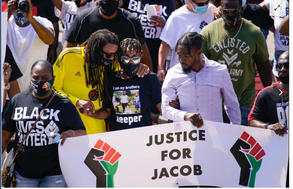 Marchers in Kenosha protest the August 23rd police shooting of Jacob Blake