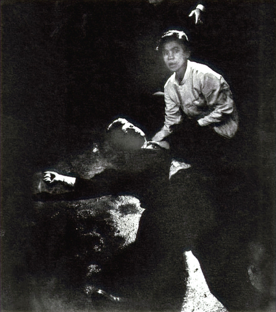 A busboy tries to comfort the mortally wounded Robert Kennedy, lying on the kitchen floor in a pool of blood