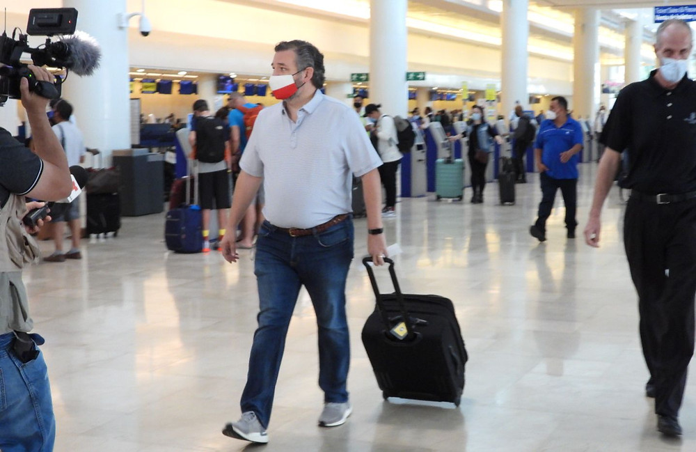 Ted Cruz sneaking through a Houston airport last Wednesday