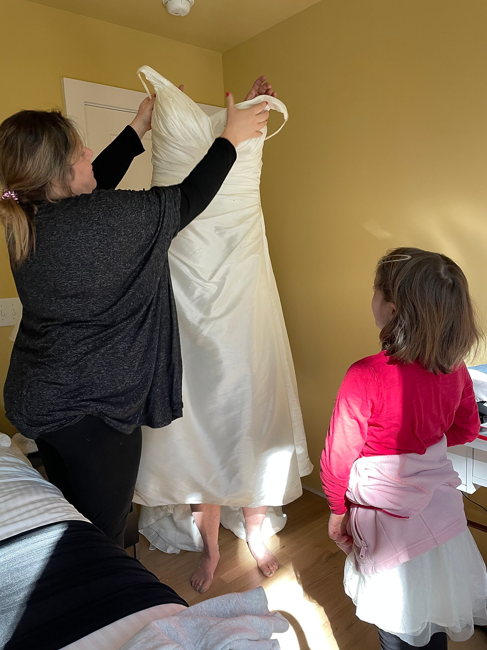 Venus Emerging: Jenna Alstad (l) helps Jane into the gown she wore at her wedding, with help from Baker Alstad (r)