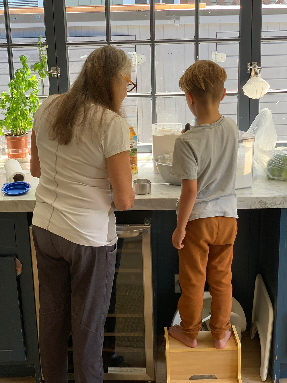 Nana and her seven-year-old grandson making batter