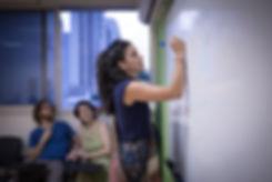 Qualified Israeli teacher writes on whiteboard