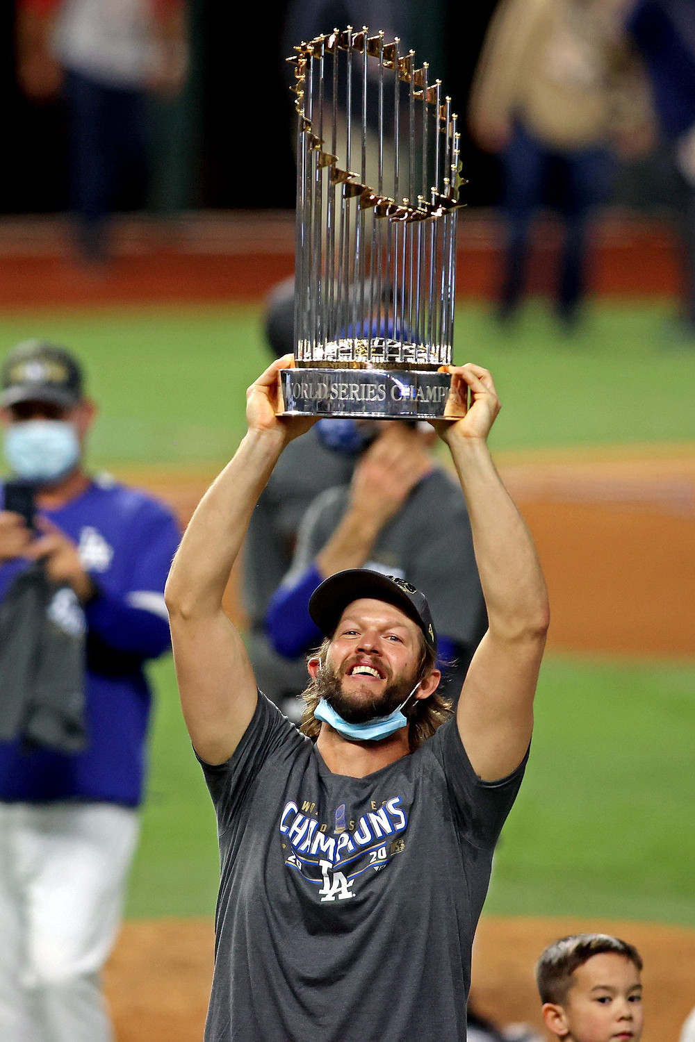 Future Hall Of Famer Clayton Kershaw holds his first World Series trophy at the age of 32