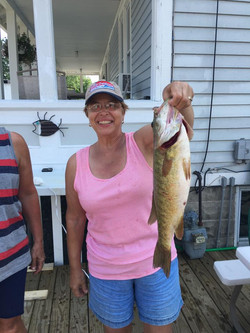 Woman with her catch on Lake St. Clair