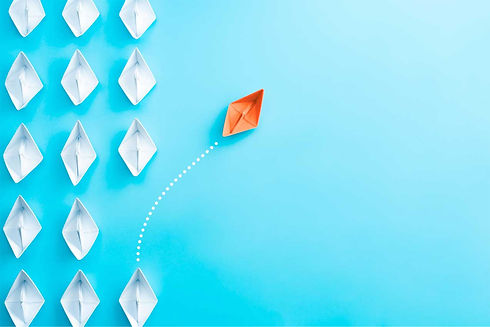 An image of a paper boat charting a new path.