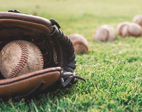 white-baseball-ball-on-brown-leather-bas