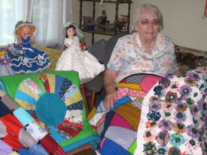 Quilter,-Betty-Byer-holds-just-a-small-sampling-of-the-many-quilts-she-has-created-over-the-years