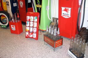 Wally Kill's oil containers on display show the progression in the oil offerings for service stations, including glass and metal containers. Photo by Carol Stender