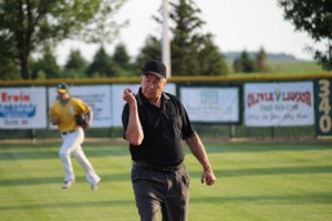 Wayne Cook calls a runner out at first base while umpiring another amateur baseball game in Bird Island. Photo by Steve Palmer