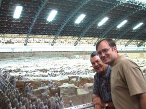 "Dale Nordby and his son, Jess, with hundrews of ""terracotta warriors"" that have have been uncovered or are partially uncovered.         Contributed photo"