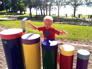 Levi Benjamin, son of current Buffalo Rotary President Emily Benjamin plays the drums at the playground at Sturges Park in Buffalo at a Rotary picnic last summer. The drums are one of the 11 instruments along the trail. Contributed photo