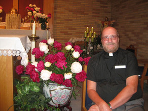 A priest and his peonies