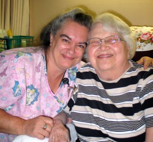 Registered nurse Donna Koester gives resident Penny Beske a hug. Penny likes the personal care Koester and others give to the residents at LB Homes.        Photo by Carol Stender
