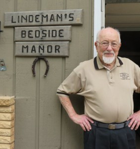 "The sign on his house is ""Lindeman's bedside manor."" He had this same sign at his home on Lake Koronis. Photo by Bev Ahlquist"