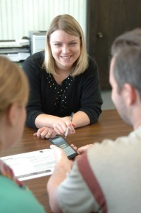 Stacey Pederson, customer service representative, shows a couple the new mobile apps available through Eagle Bank. Photo by Jim Palmer.