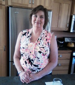 Donna Ebner in her kitchen. Ebner likes to use goats milk to make various products like soaps and lotions. She also experiments with other natural products such as oils and plants. Photo by Karen Flaten