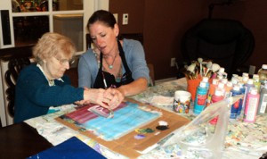One fun activity at The Garden House is painting with watercolors. Above, a resident and staff member work together on a masterpiece. Contributed photo