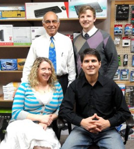 The Mobiz team, pictured by the retail area in their Morris office, includes (front L to R) Amanda Bohm, Tucker McCannon, (back L to R) Roger McCannon, and Patrick Janachovosky. Contributed photo