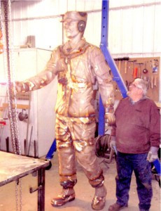 Tom Miller, the welder, with one of the large pieces of the statue.