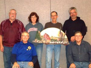Members of the Central Minnesota Woodcarvers Association (standing, L to R),  Al Gerads, Brenda Lodermeier, Ken Ramler, Mike Lodermeier, (seated L to R), Curt Hutchens, Ron Lorenz, worked on this project which raised over $800 for Quiet Oaks Hospice. Contributed photo