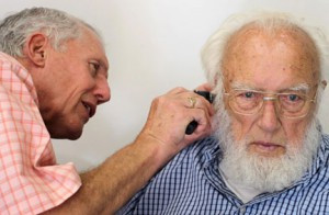 Greg Wales gets a closer look at a patient's ear canal. Contributed photo