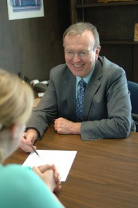 Ralph Gaffaney, vice president, talks with a customer about different loan options. Photo by Jim Palmer.
