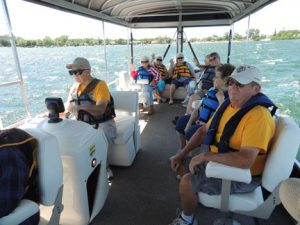 A boat of seniors from  Dethlefs Center takes a voyage on Green Lake near Spicer. Contributed photos