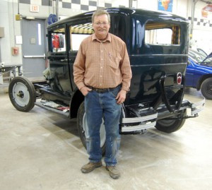 Donald Korstad with his 1928 Chevrolet National AB five-passenger coach. Korstad is restoring the car as a retirement project.
