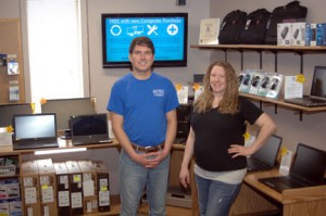 Tucker McCannon and Amanda Bohm next to some of the retail items available at the Mobiz office in Morris. Each product is backed by Mobiz. Photo by Jim Palmer
