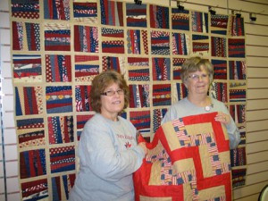 Penny Miller, left and Paulette Hoebelheinrich are members of Quilters Embrace, a group of Otter Tail County quilters making and distributing quilts to military veterans.