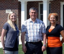 Jenna Kamphenkel, RN/Housing and Clinical Service manager at Birchwood House; Mark Austin, director of Area Development for Prairie River Home Care; and Ashley Maiers, Hutchinson Branch manager for Prairie River Home Care, in front of the Birchwood House. The home specializes in caring for people with progressive movement disorders.