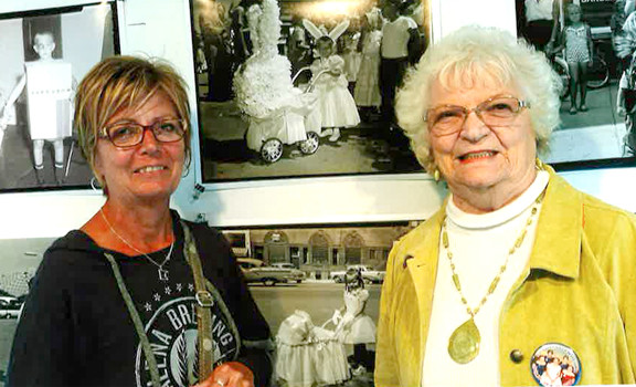 Millie Zavadil, right, and her daughter, Lynn Staples, posed by a photo from the 1960 Waterama Kiddie Parade (also pictured above). Lynn was participating in her first parade that year. Contributed photo
