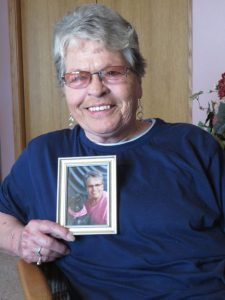 Renee Hanson holds a photo of her and her dog, Bailey. Doctors believe Renee contracted a bacteria from the dog that nearly killed her. Contributed photo