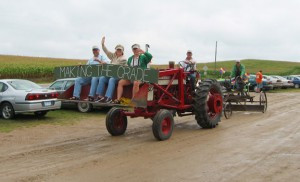 'Making the grade' with an antique road grader is humor in the spirit of the Burma Road Parade.