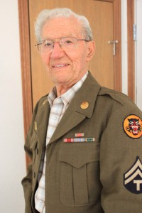 Wally Frank, age 94, can still  fit into his Eisenhower-style waist-length Army jacket 70 years after his WW II service with the 419th Field Armored Artillery Battalion of the famed 10th Armored Division in Europe.          Photo by Steve Palmer