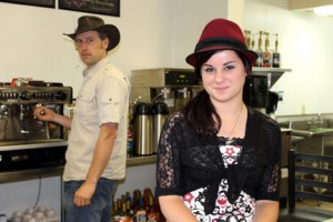 Hats are everyday wear for Daiv Freeman and Rosalie Talley at Hats Off Coffee in Long Prairie.  Photo by Nancy Leasman