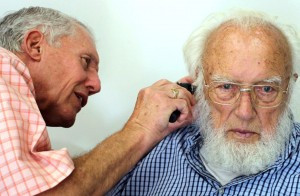 Greg Wales gives an ear exam to a patient at Wales Hearing Center in Alexandria. Contributed photo