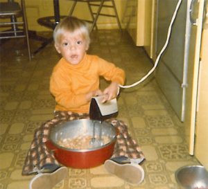 Jim Palmer, editor/publisher of Sr. Perspective, working on a batch of cookies on the kitchen floor at age 4.
