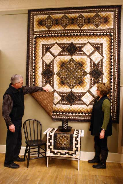 Don-and-Bonny-showing-quilt