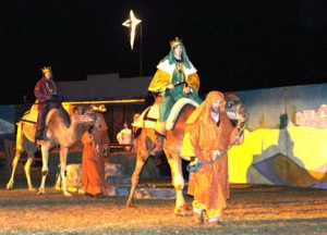 Part of the pageant includes three kings and a couple camels. On the camels are Daniel O'Callaghan and Andrew Beckman and the trainers walking along side are Kevin Voge and daughter, Cheyanne Vogel, from Vogel's Exotic Animals. Photo courtesy of Springfield Advocate-Press
