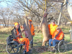 Hunters and helpers pose for a photo after a successful hunt. Contributed photo.