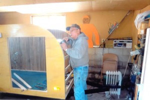 Dean works on the outer shell of the teardrop. Contributed photo