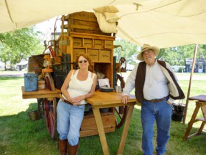"""Joyce Schumacher and John Hallson, of Dassel, are reliving and telling the history of the """"chuckwagon"""". John built his own chuckwagon and with the help of Joyce, travels to many states and serves food from their wagon. Photo contributed."""