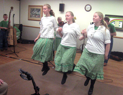 Some of the girls from the Becker family dance on St. Patrick's Day at the Pine Villa Care Center in Melrose. The group is called Slewfoot. Photo by Jean Paschke