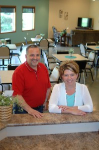 Business partners, Jay Vachal, CEO of Arise Cares, and Margaret Kotula, recently opened Arise Cares Senior Day Program in Sartell. The two are pictured in the large cafeteria-style room at Arise Cares. Photo by Jim Palmer
