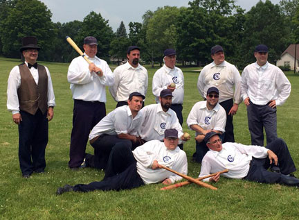 "The St. Croixs posed for a photo with the umpire after a recent game. The guys are holding their ""willow sticks"" and ""onions.""  Photo courtesy of the Washington County Historical Society."