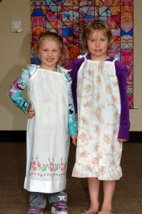 Emma and Brooklyn, 5-year-old girls from Hutchinson, modeled two of the dresses that will be shipped to Haiti this month. The dresses were made from pillowcases by the ladies of Peace Lutheran Church of Hutchinson.