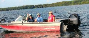 Don, Nancy and Marilyn Carlson enjoy a boat ride on Lake Ida in 2015. Knute Nelson Hospice helped Don enjoy his lake home during his last summer. Don passed away earlier this year. Contributed photo