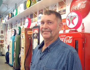 Wally Kill, of Morris, could open his own gas station. He has it all at his farm place, from gas pumps to air hoses to oil containers and more. All he needs is the fuel. But it's all part of his vintage gas station memorabilia collection which includes the roughly 50 gas pumps he's restored. Photo by Carol Stender