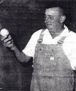 John Anderson (in a 1966 photo) holds the baseball he pitched to Bud Chastek, who hit it into the dog house for a home run. Photo contributed.